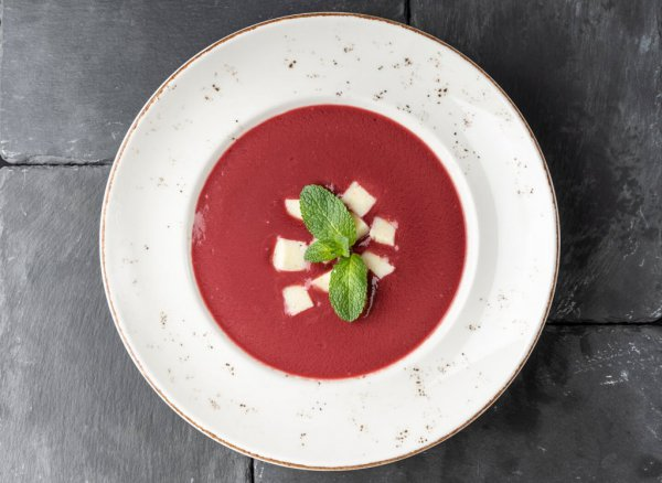 Coconut -raspberry soup with sesame seeds flavoured cream of